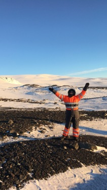 Me in my astronaut suit with a glacier behind me.